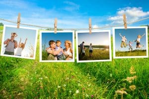 Family pictures hanging on a clothesline in the yard. 3 LIfe-Changing Ways to Create Family Memories