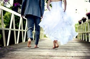 married couple walking across a bridge. Got Stuck? How to Agree on Faith as a Married Couple