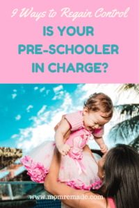 9 Sneaky Ways Your Pre-Schooler is in Charge and How to Fix It. Mom holding up a little girl in the air.